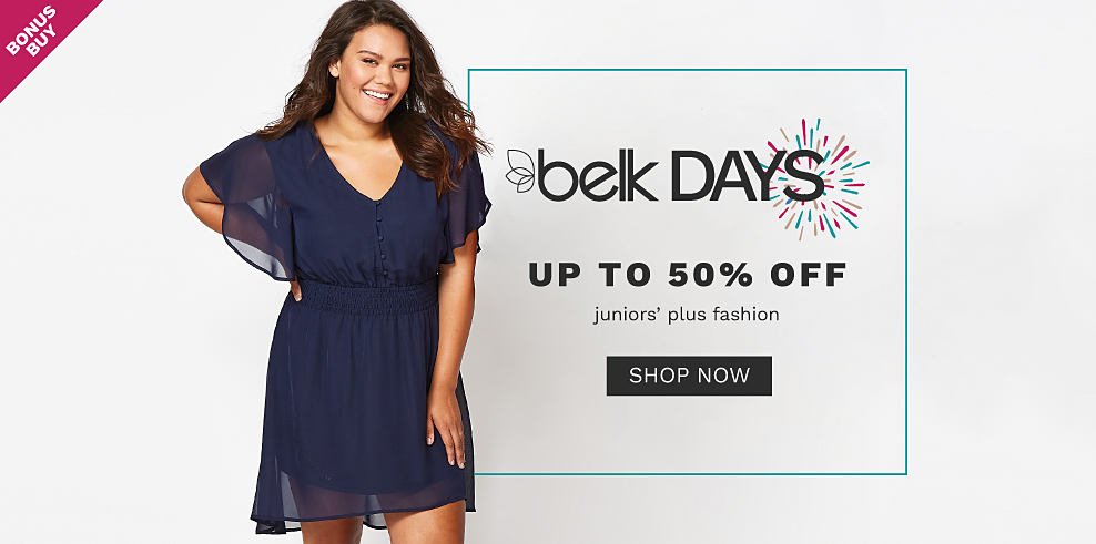 A young woman wearing a navy short sleeved dress standing next to a young woman wearing a long sleeved multi colored floral print top & blue jeans. Belk Days. Bonus Buy. Up to 50% off juniors fashion. Shop now.