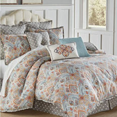 A bed with a printed comforter. Shop comforters.