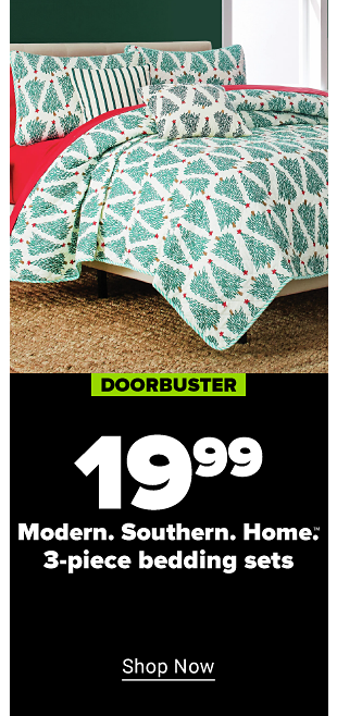 A large bed with christmas tree printed covers and pillow cases, and red sheets. Doorbuster. $19.99 Modern. Southern. Home. three piece bedding sets. Shop now.