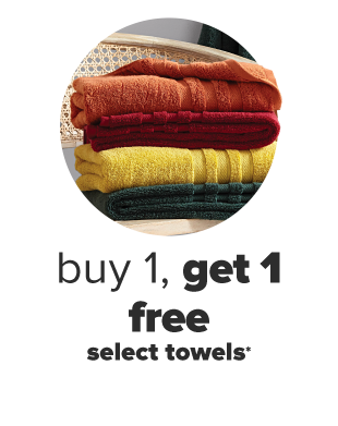 A stack of folded towels in a variety of fall colors. Buy 1, get 1 free select towels.