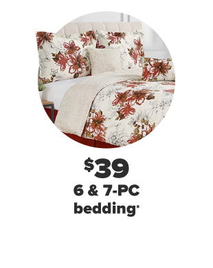 A bed with a white and red floral print comforter and pillows to match. $39 6 and 7 piece bedding.