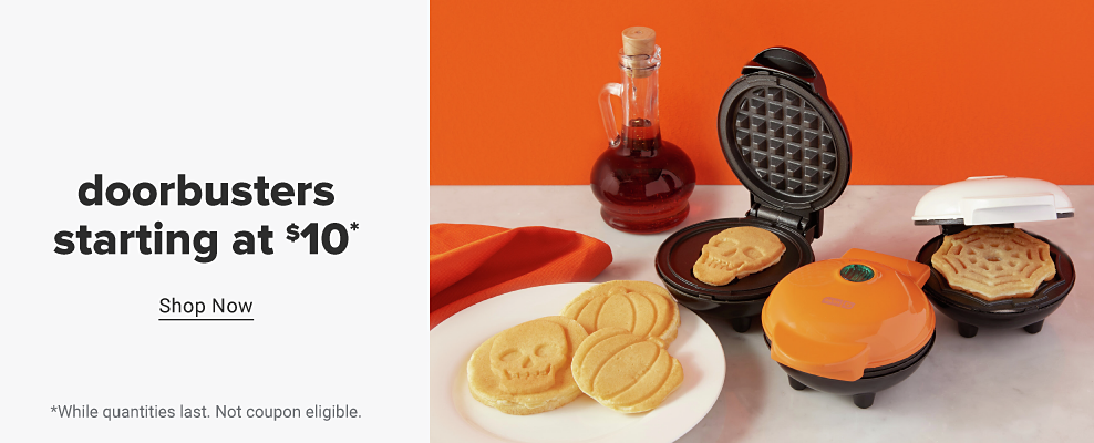 Three Dash mini waffle makers in dark red, orange and white. A spread of Halloween-themed waffles on a table including skull, spiderweb and pumpkin-shaped waffles. Doorbusters starting at $10. Shop now. While quantities last. Not coupon eligible.