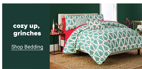 A bedding set featuring a Christmas tree design, coordinating bed sheets, matching pillow shams and small matching pillows. Cozy up, grinches. Shop bedding.
