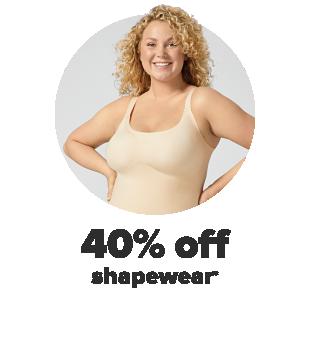 A woman wearing beige shapewear. 40% off shapewear.