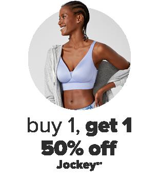 A woman wearing a light blue bra with a grey open front cardigan. Buy 1, get 1 50% off Jockey.