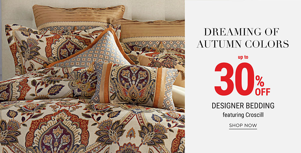 A bed made with a multi-colored patterned comforter & matching pillows. Dreaming of Autumn Colors. Up to 30% off designer bedding. Shop now.