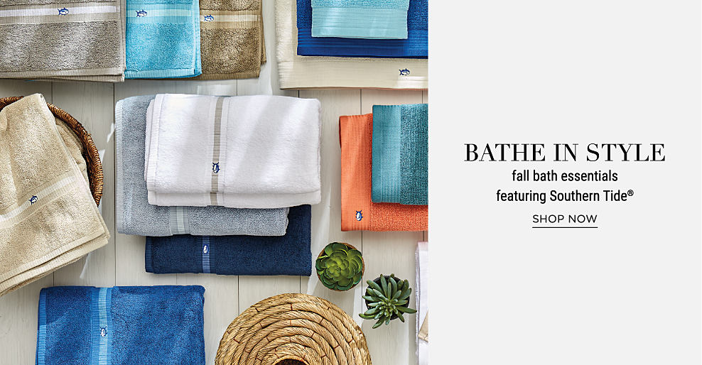 An assortment of folded bath towels in a variety of colors. Bathe in style. Fall bath essentials featuring Southern Tide. Shop now.