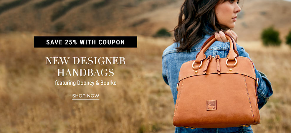 A woman wearing a denim jacket holding a brown leather Dooney & Burke handbag. Save 25% with coupon. New designer handbags featuring Dooney & Bourke. Shop now.