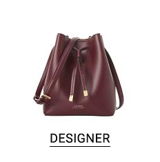 A black leather drawstring tote. Shop designer