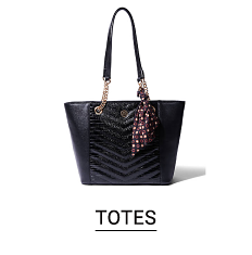 A black leather bucket tote. Shop totes.