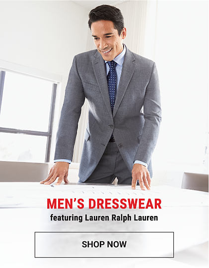 A man wearing a gray suit, a light blue dress shirt & a navy tie with white polka dots. Men's dresswear featuring Lauren Ralph Lauren. Shop now.