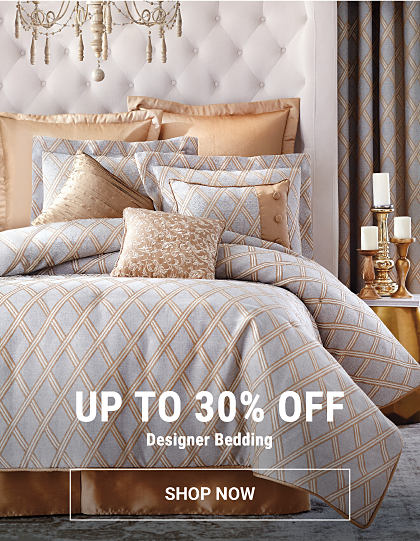 A bed made with a gray & gold patterned comfoter & matching pillows. Up to 30% off designer bedding. Shop now.