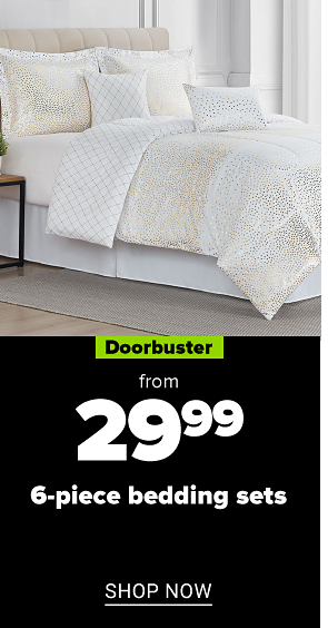 A bed with a white and beige print comforter and pilows to match. Doorbuster. From 29.99 6 piece bedding sets. Shop now.