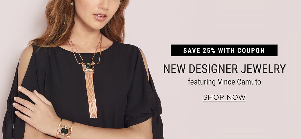 A woman wearing a black cold-shoulder top, an ornate gold & gemstone necklace & an ornate gold & gemstone bracelet. Save 25% with coupon. New designer jewelry featuring Vince Camuto. Shop now.