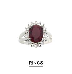 A silver tone & dark gem stone ring. Shop fashion jewelry rings.
