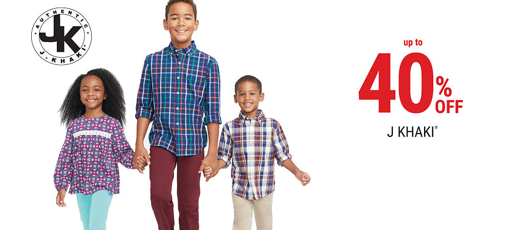 A girl wearing a blue, red & white patterned top & aquamarine pants standing next to a boy wearing a blue, white & red plaid button-front sshirt & brown pants & a boy wearing a brown, blue & white plaid button-front shirt & khaki pants. Up to 40% off J Khaki. Shop girls. Shop boys.