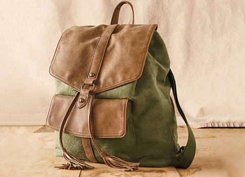 A brown leather & green canvas backpack purse. Accessories. Shop now.