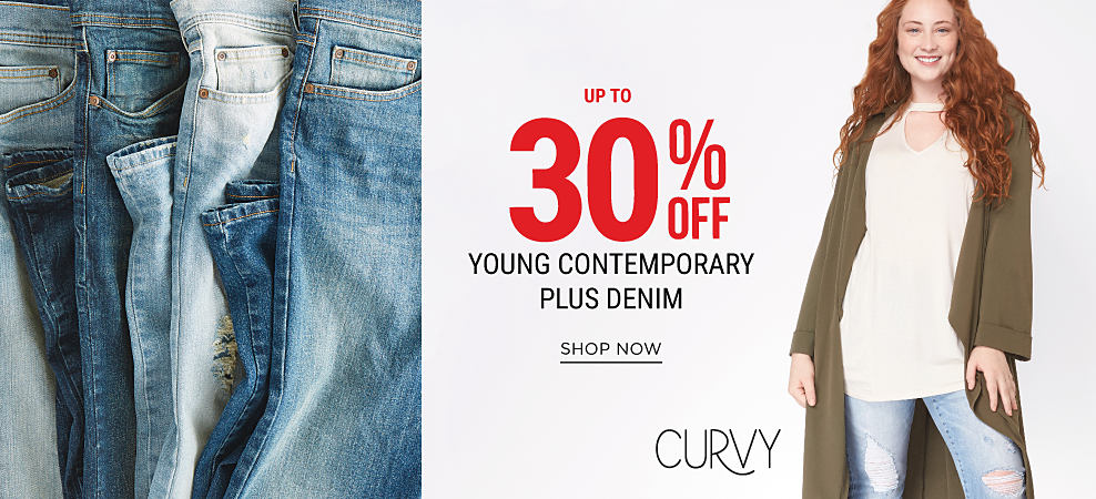 An assortment of blue jeans in a variety of washes. A woman wearing a long olive green sweater, a white top & distressed blue jeans with floral detail. U[p to 30% off young contemporary plus denim. Shop now.