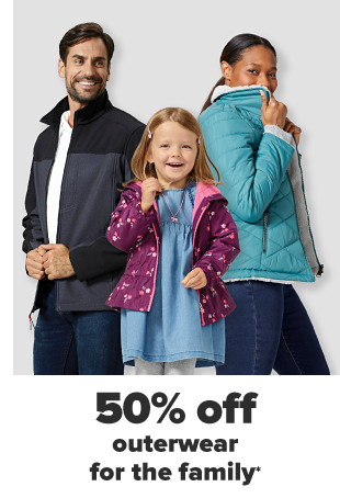 A man in a white tee, a gray and black jacket and jeans. A woman in a teal puffy jacket and jeans. A little girl in a blue dress and a floral magenta jacket. 50% off outerwear for the family.