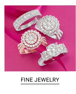 An assortment of gold & diamond rings, silver & diamond rings & silver & diamond bracelets. Shop fine jewelry.