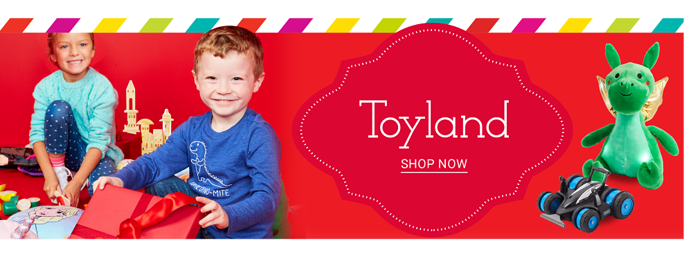 A boy & a girl surrounded by an assortment of toys. Toyland. Shop now.