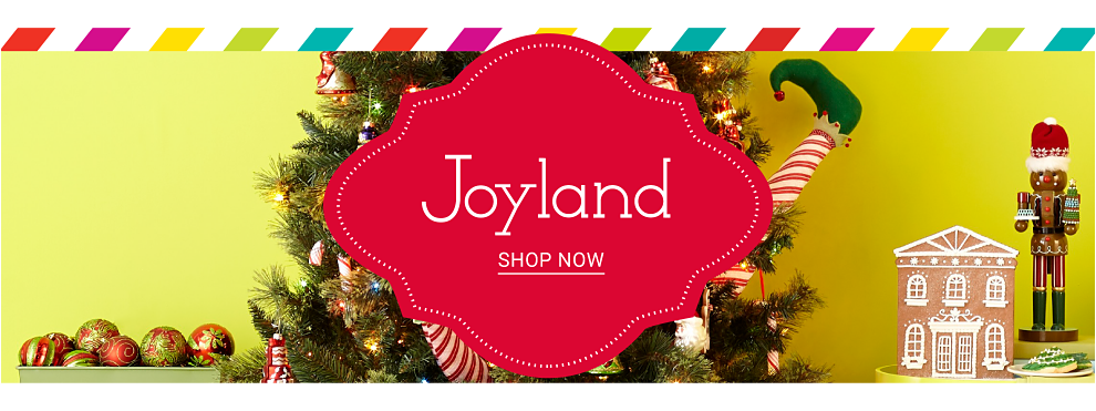 A boy wearing sunglasses, a blue & white plaid long sleeved button front shirt sitting in a little white convertible car. Joyland. Shop now.