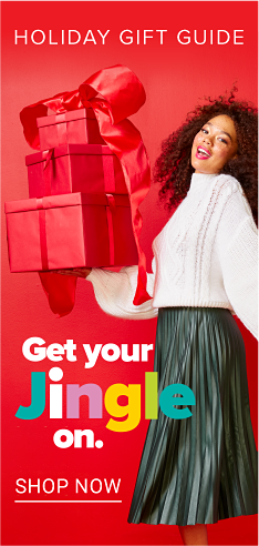 A woman wearing a white blouse & black pants holding presents wrapped in red wrapping paper & bows. Holiday Gift Guide. Get Your Jingle On. Shop now