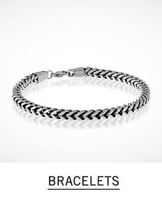 A braided silver tone men's bracelet. Shop men's bracelets.