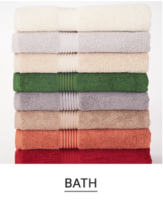 A stack of folded bath towels in a variety of colors. Shop bath