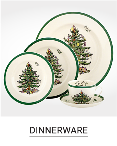 An assortment of white & green Christmas tree plates. Shop dinnerware.