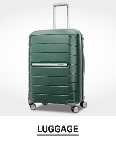 A green hardside wheeled suitcase. Shop luggage.