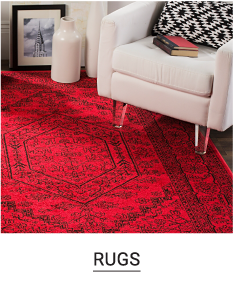 A white chair on a red rug. Shop rugs.