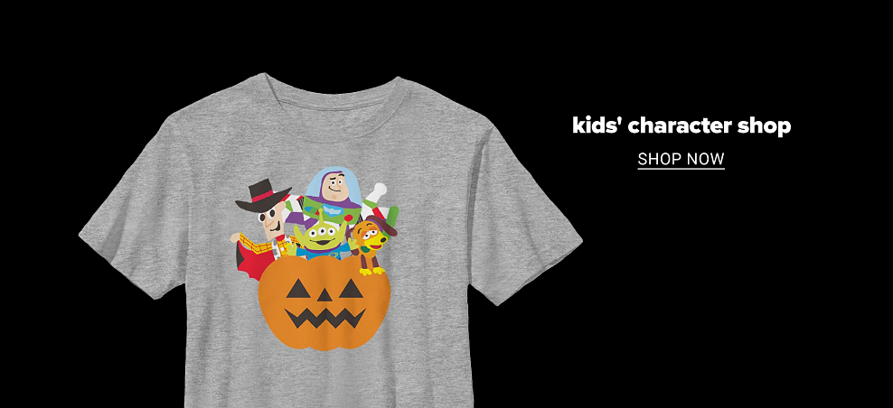 A gray heathered tee shirt with a graphic of the cast of Toy Story popping out of a jack o lantern. Kids' character shop. Shop now.