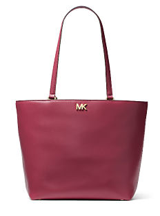 A burgundy leather tote with gold logo hardware. Shop Michael Michael Kors.