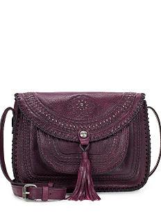 A burgundy hand-tooled leather handbag. Shop Patricia Nash.