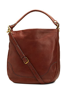 A brown leather backapck purse with gold hardware detail. Shop Frye.