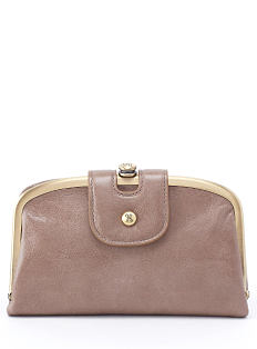A light brown leather clutch. Shop Hobo.