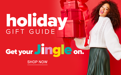 A woman wearing a white blouse & black pants holding presents wrapped in red wrapping papaer & bows. Holiday Gift Guide. Get your jingle on. Shop now