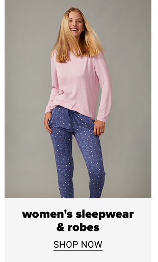 A woman in a pink long sleeve tee and blue pants with a pink print. Women's sleepwear and robes. Shop now.