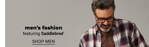 A man in a brown tee topped with an open front brown, red and beige plaid long sleeve shirt, jeans and a brown belt. Men's fashion featuring Saddlebred. Shop men. Shop big and tall.