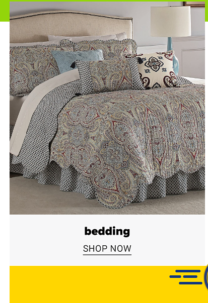 A bed with a light blue and light brown print quilt with pillows to match. Bedding, shop now.