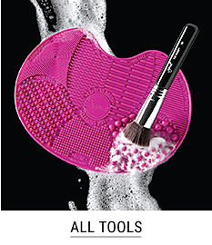 A makeup brush & a brush cleaner. Shop all tools.