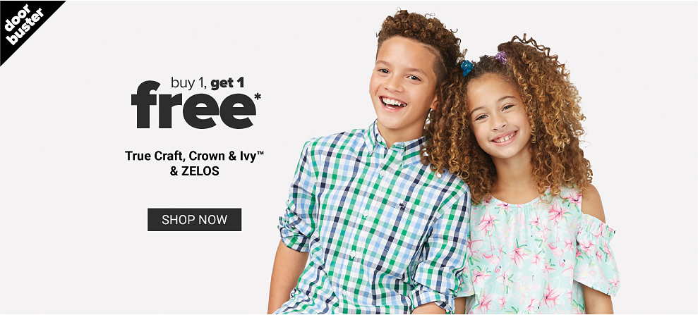 A boy in a navy, light blue, green and white plaid button front shirt. A girl in a short cold shoulder sleeve floral blouse. Doorbuster. Buy 1, get 1 free, True Craft, Crown and Ivy, and Zelos. Shop now.