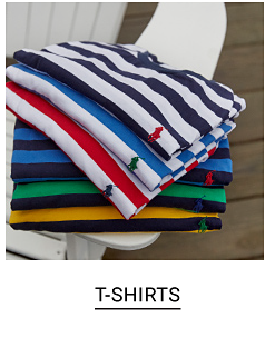 A stack of folded stripe tee shirts in a variety of colors. Shop tee shirts.