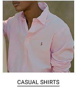 A man in a light pink dress shirt. Shop casual shirts.