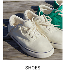 A pair of white sneakers and a pair of green sneakers. Shop shoes.
