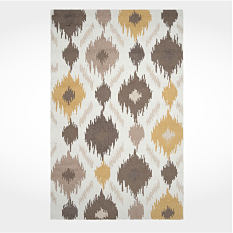 A brown, yellow, and white printed rug. Shop rugs.