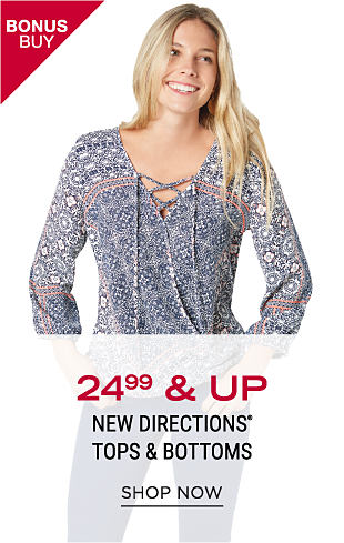 A woman wearing a multi-colored print long-sleeved peasant blouse. Bonus Buy. $24.99 & up New Directions tops & bottoms. Shop now.