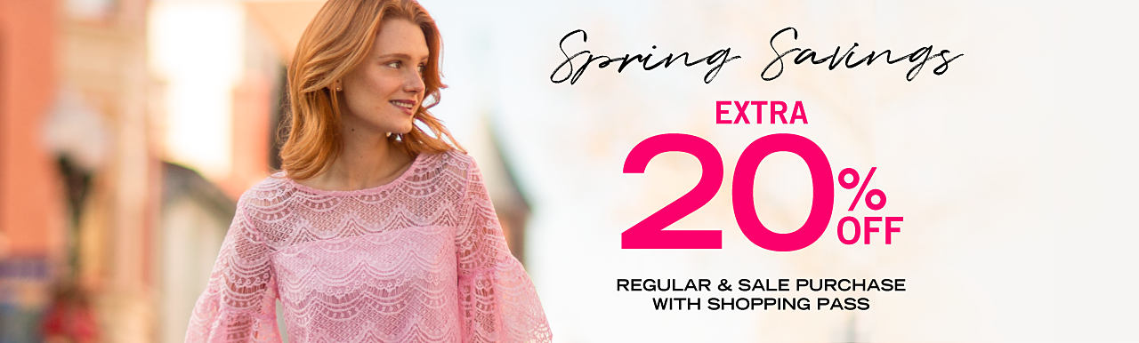 A woman wearing a pink lace-detailed top. Spring savings. Extra 20% off regular & sale purchase with shopping pass.