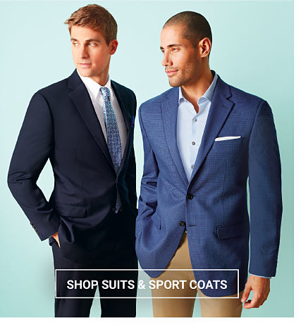 A man wearing a black suit, a white dress shirt & a light blue tie standing next to a man wearing a blue blazer, a light blue dress shirt & beige pants. Easter Dresswear for the Family. Up to 50% off. Shop suits & sport coats..
